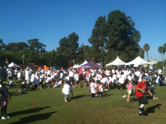 Walkers of all ages and abilities warming up during last year's iWalk... for Kids.