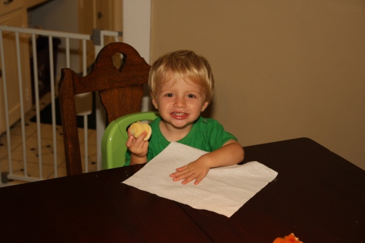 Two-year-old T enjoying his party cupcake leftovers once the party-goers left the building.