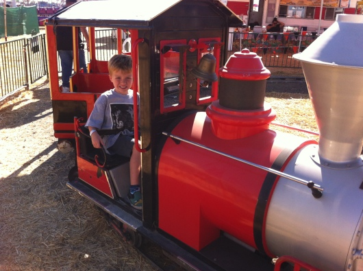 If anything, we go to Pa's each season so T gets to drive that red train! Hard to believe this is his 6th season riding this train!