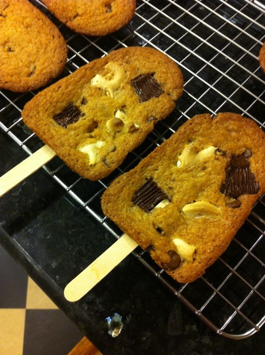 """Cakesicle """"blondies"""" with yogurt-coated pretzels and peanut butter cups."""