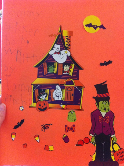"The ""cover page"" of T's Halloween sticker book he made for Mrs. K!"