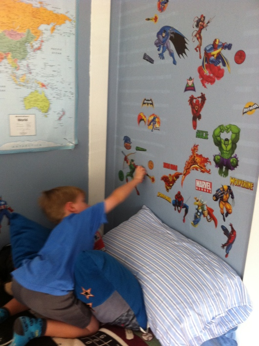 Bye, bye superheroes! T's ready to move on. Thankfully, RoomMates wall decals make room redecorating easy.
