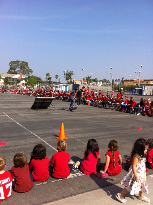 "Carlos performed a few extra tricks and turns. Here he's doing 10 ""360 kick-flips"" in a row as the kids cheer him on."