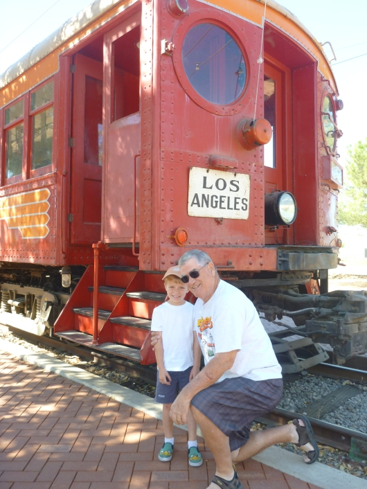 "T and JoePa in front of one of several of the original Pacific Electric ""Red Cars"" located at the Orange Empire Railway Museum."