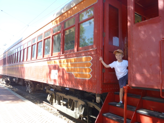 "T getting on board an old ""Blimp"" PE Red Car at the Orange Empire Railway Museum."