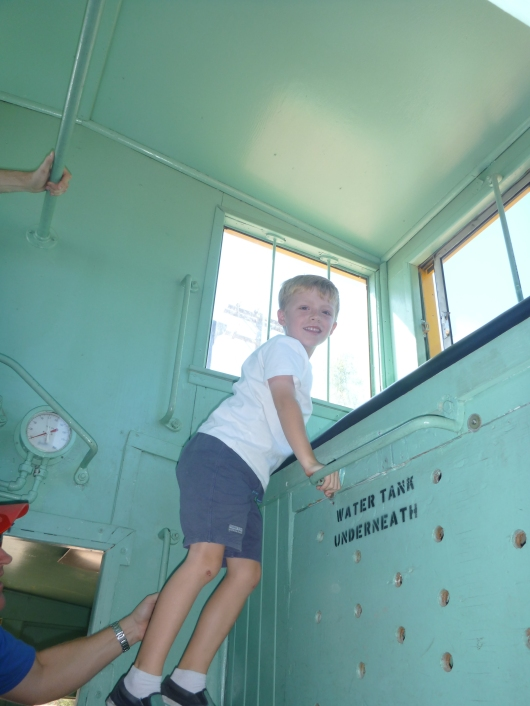 T climbed up atop this lookout area inside one of the cabooses he rode in during one of many of our train rides on a visit to Orange Empire Railway Museum.