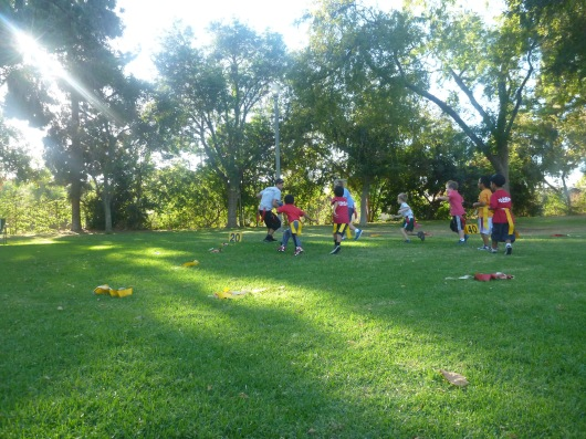 The kids ran through a few different plays at their first flag football practice.