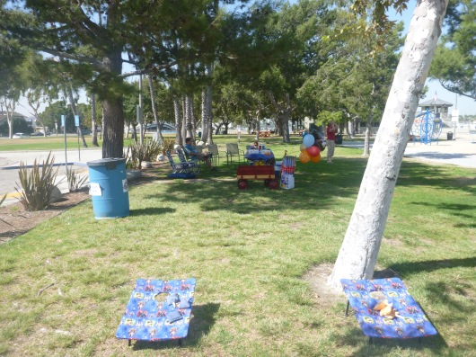 Our party area. C did a great job snagging a slice of shade on a gorgeous but breezy day.