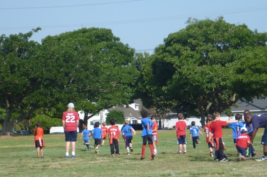 T running the ball around and through the other team's defense.