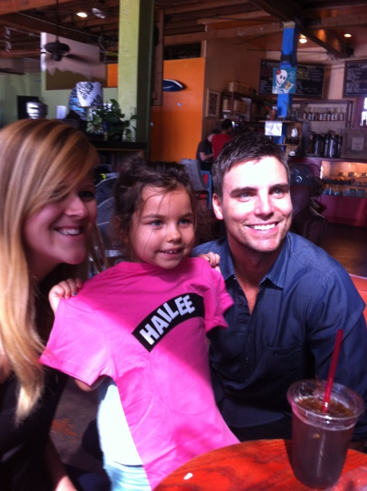 H's nanny, H, and Colin Egglesfield posing with the Shout Out! T-shirt.