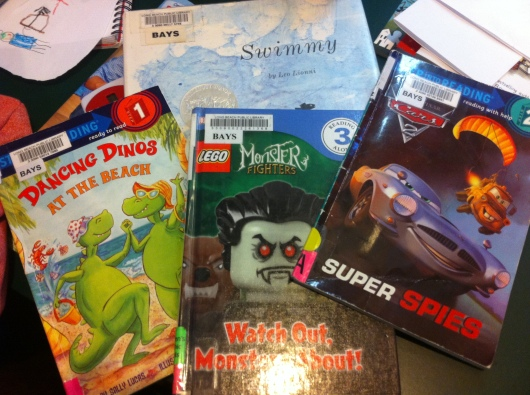 Some of T's latest haul from the library. I think you can see which books he chose and which one I put into the mix.