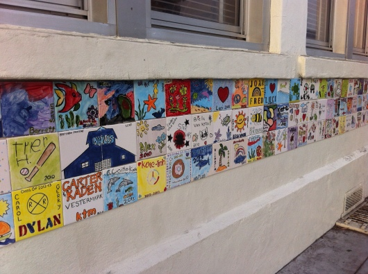 Just one small tiled section of the school's exterior walls where the finished tiles will become a permanent part of the community. Such a wonderful idea!