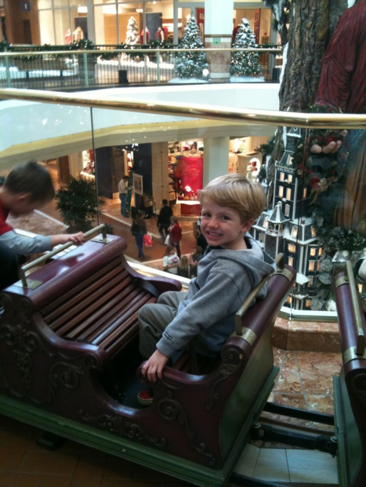 T aboard the South Coast Plaza's Holiday Express in 2011. We haven't missed this train since T turned two-years-old or so. This is also a wonderful place to visit with Santa and take home a holiday craft!