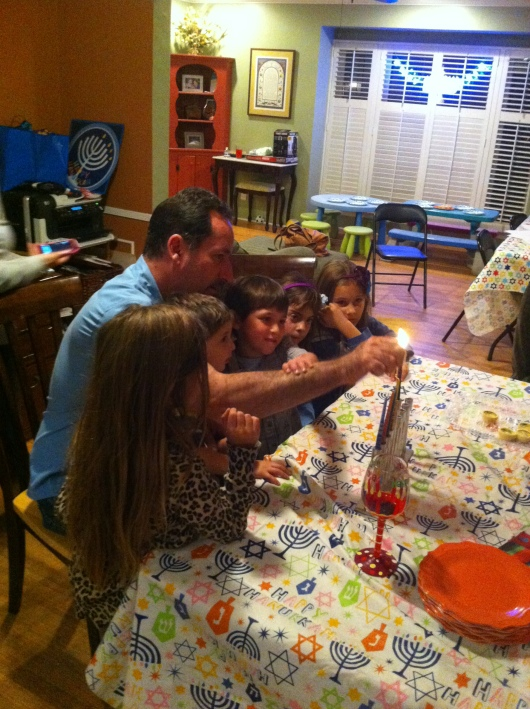 Our friend helped the kids light the Menorah on Night Five during a small Hanukkah gathering at their home.