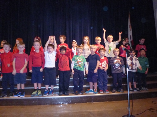 "T's class and the other Kinders all sang a song based on a German drinking song, ""Must Be Santa."" Well, the school did claim the show was internationally focused. Cheers!"