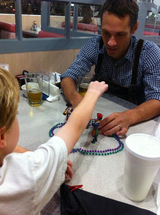 T keeping C's friend entertained as we waited for our food at Rick & Brian's on German Night a few weeks back.