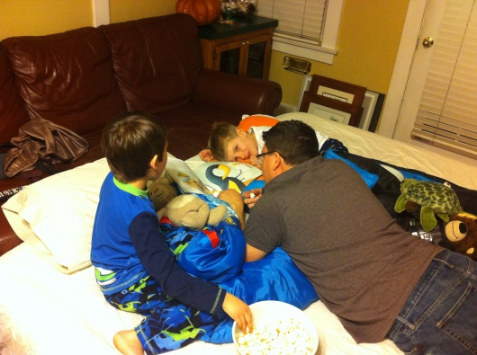 Finally, some calmer times settled in for the evening, thanks to C reading the boys a story with their popcorn.