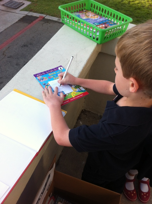 T fills out his book-plate for his Milk + Bookies donation.