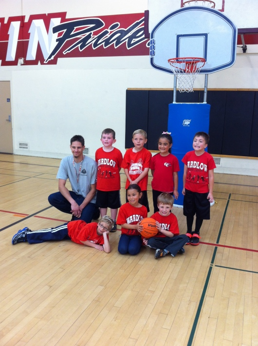 T's basketball team photo. Thanks to Coach Chris for another awesome youth sports season!