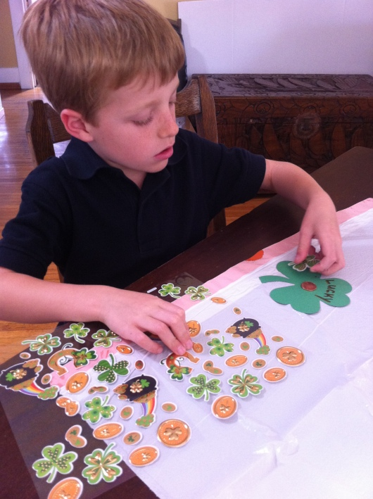T put all the stickers and names onto the Lucky Pennies he made for his classmates.