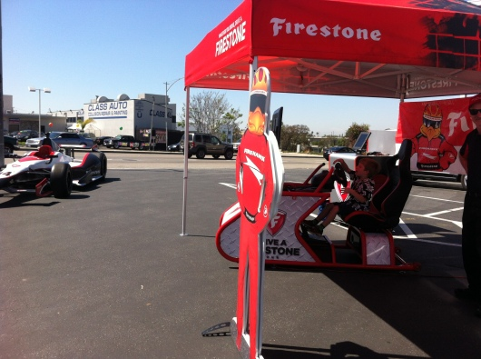 If you see this set up at the corner of Cherry Avenue and Spring Street today, stop by for some free Grand Prix-related fun!