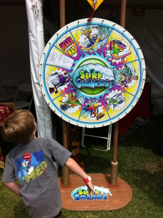 ... to spin this wheel... to win a bookmark. Not the best marketing ploy when the author noticed that people were leaving disappointed because they didn't get a shark hat. D'oh!