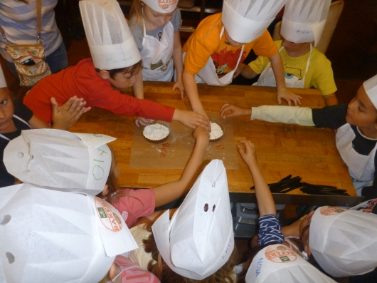 The kids got to feel the difference between all-purpose flour and the rice flour that Panera uses as part of their bread baking process. They were shown the difference in how the rice flour is softer and also leaves less char marks and residue on the loaves during the baking process.