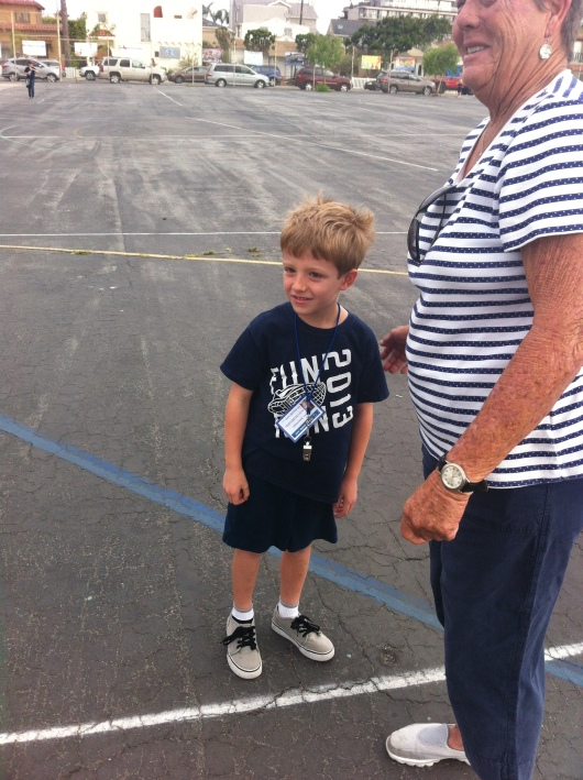 T gets his nametag and whistle before picking up duties on the playground as Coachie for the Day at school.