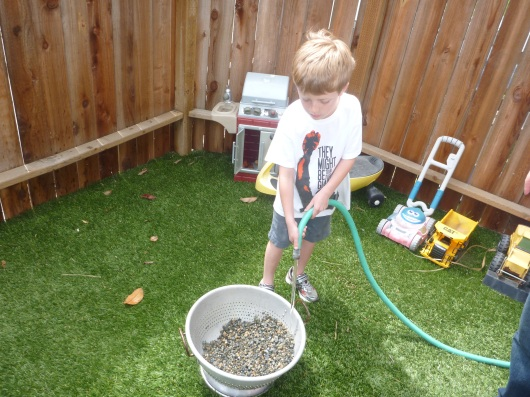T washing rocks for his science fair project.