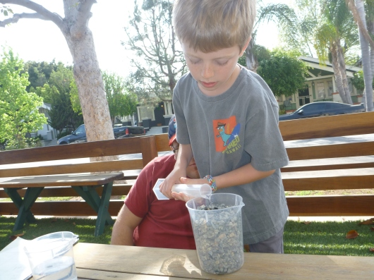 T used water to measure the pore space (AKA air) between the rocks and sand.
