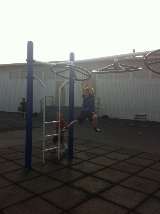 "This morning T tried on the ""grader"" playground equipment. You can do anything, T."