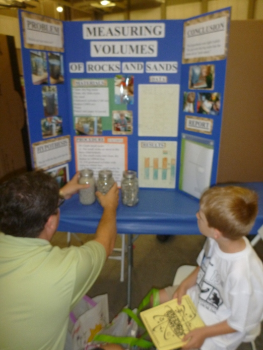 C helping T set up his project at District.