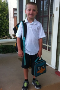 Traditional first day of school picture on the front porch (regular face).
