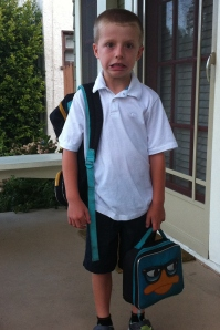 Traditional first day of school picture on the front porch (silly face).
