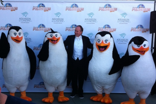 Penguins of Madagascar Executive Producer and voice actor Tom McGrath (Skippy) with the stars of the Penguins of Madagascar at the Aquarium of the Pacific.