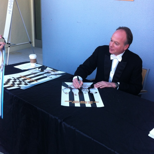 McGrath signed movie posters for attendees at the Aquarium of the Pacific's Penguins of Madagascar cross-promotional event Wednesday November 5, 2014.