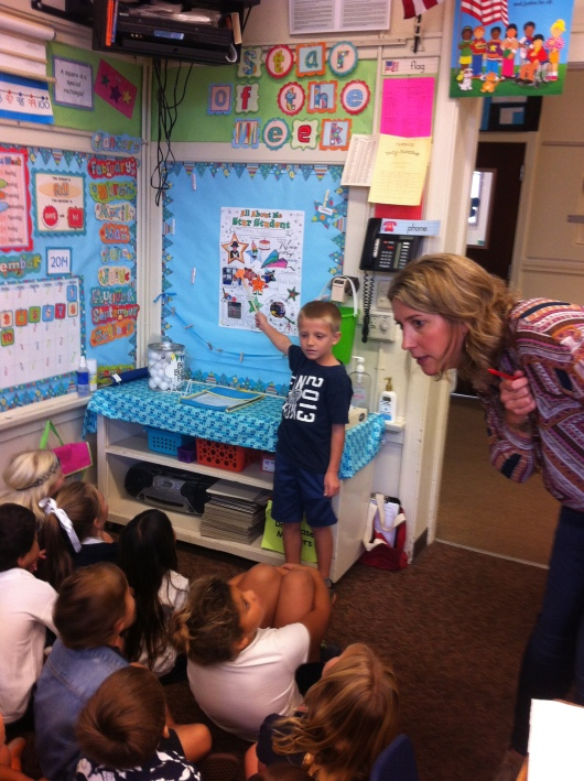 T's teacher Mrs. Allen readies the kids for T's Star of the Week presentations.