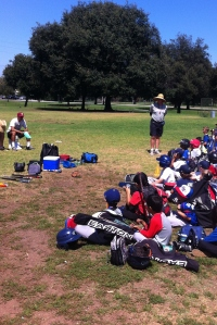 At the end of each day at Tom Hicks Baseball Camp, Grandpa re-distributes lost gear back to players.