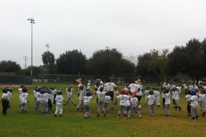 One of the crazy calisthenics sessions out at Tom Hicks Baseball Camps. It appears chaotic in person also, but it's actually organized enough to work for this age group, and that's all that matters.