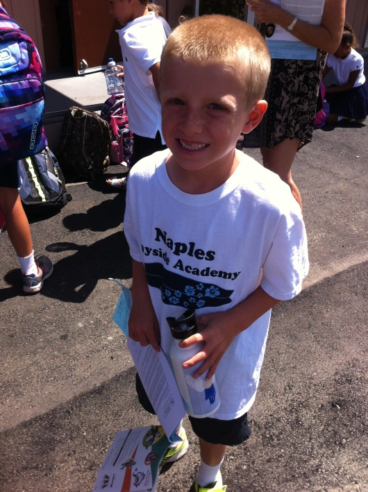 """T at the end of his first day of 2nd Grade, holding the water bottle he """"won"""" from a name raffle pull of some sort. Safe to say he had a pretty great day!"""