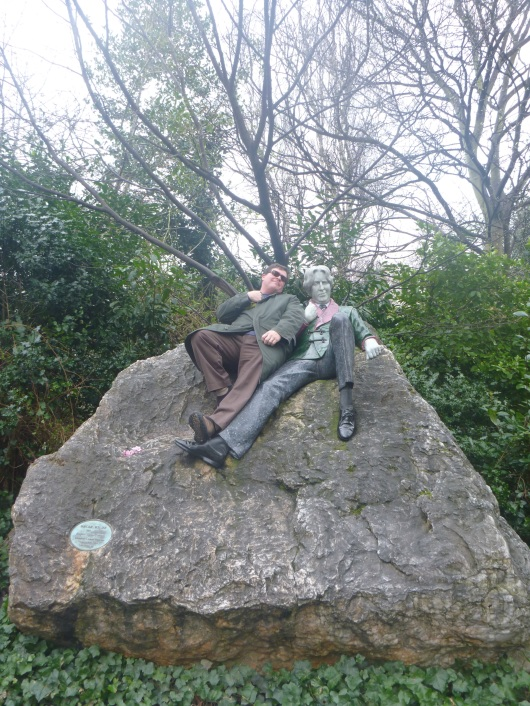 Merrion Square and the statue of Oscar Wilde, Dublin. First C dances on his grave in London, and now this.